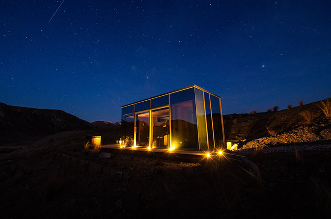 Mirrored pods reflect the landscape while remaining almost invisible