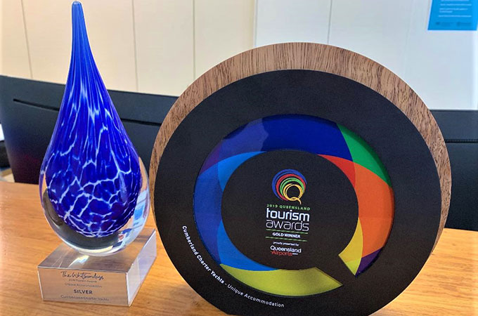 The gold gong from Queensland Tourism joins a recent silver win in the Whitsundays Tourism Awards for Cumberland Charter Yachts