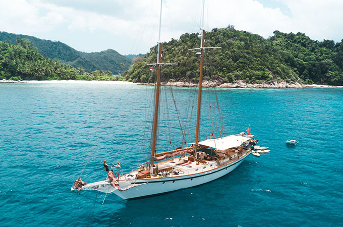 Step aboard the classic SY Dallinghoo schooner then dive deep into the Andaman Sea. Photo: Burma Boating