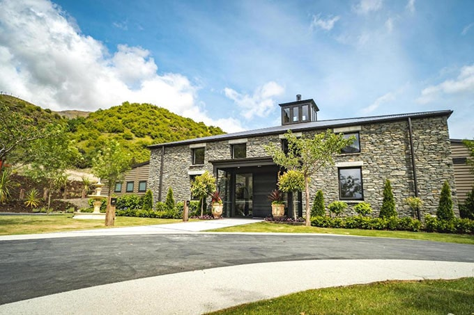 Clad in locally sourced 'schist' stone, the stunning Gibbston Valley Lodge is ready to welcome guests