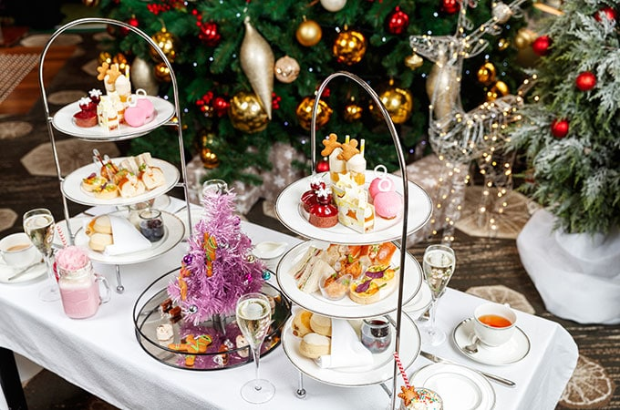 Enjoy three tiers of temptation from Anna Polyviou including the Christmas Bauble, Santa's Cherry Pie, Tropi-cola Trifle, Presents Under The Tree, and scrumptious savouries
