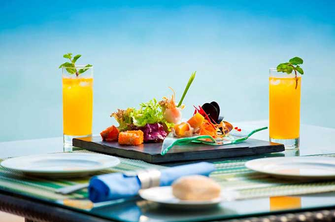 Enjoy plastic-free dining at the Banyan Tree Samui, overlooking a private bay and the azure Gulf of Thailand.