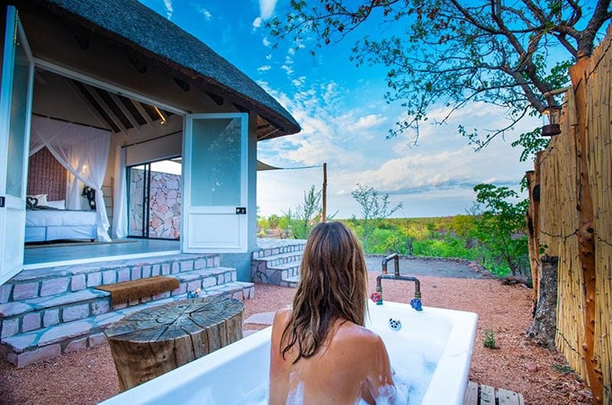 More time at your destination means more time to luxuriate in your outdoor tub (and observe the wildlife of course). Photo: Jenman Safaris